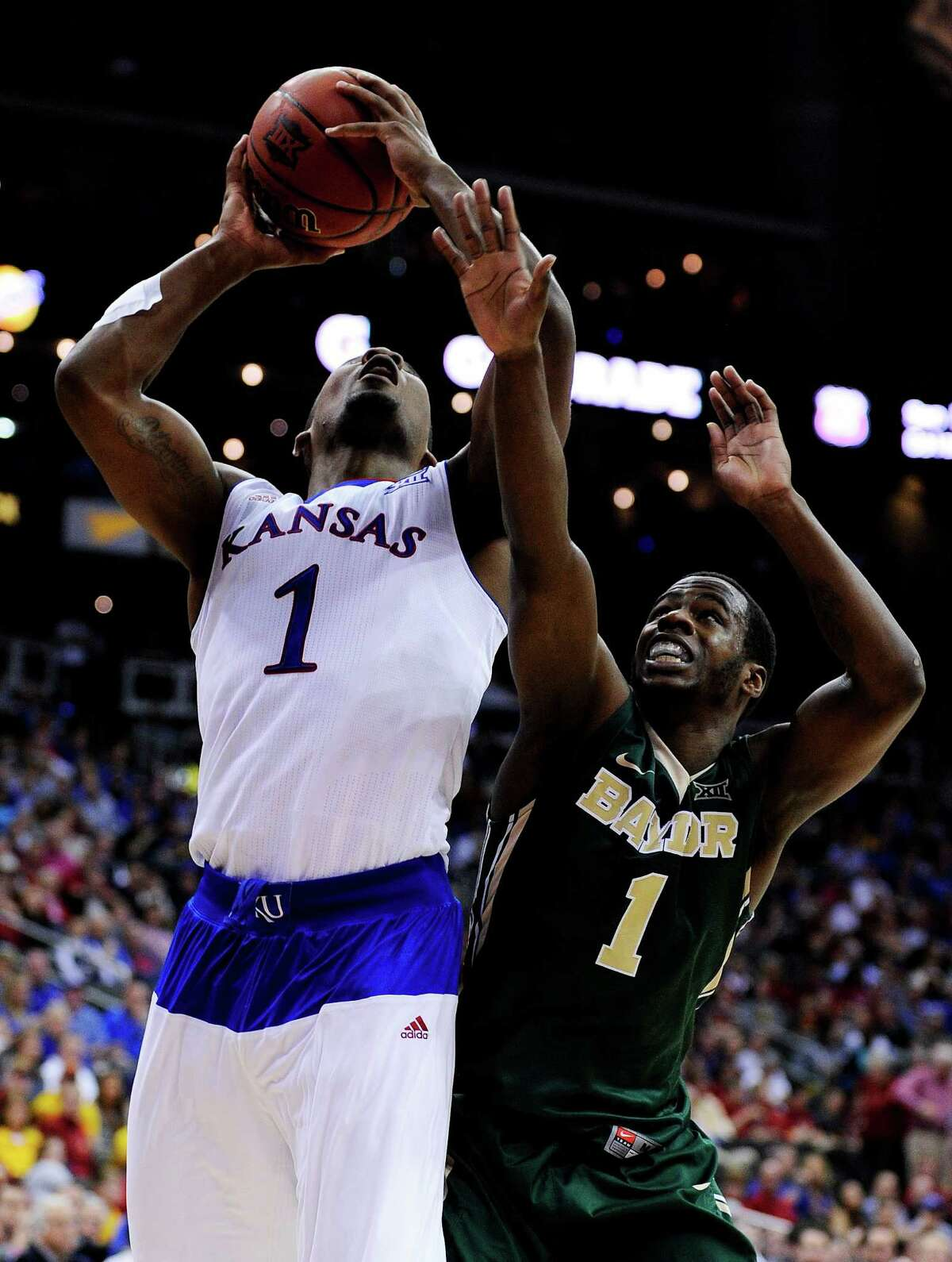 KANSAS CITY, MO - MARCH 13: Wayne Selden Jr. #1 of the Kansas Jayhawks goes up against Kenny Chery #1 of the Baylor Bears in the second half during a semifinal game of the 2015 Big 12 Basketball Tournament at Sprint Center on March 13, 2015 in Kansas City, Missouri. (Photo by Ed Zurga/Getty Images)