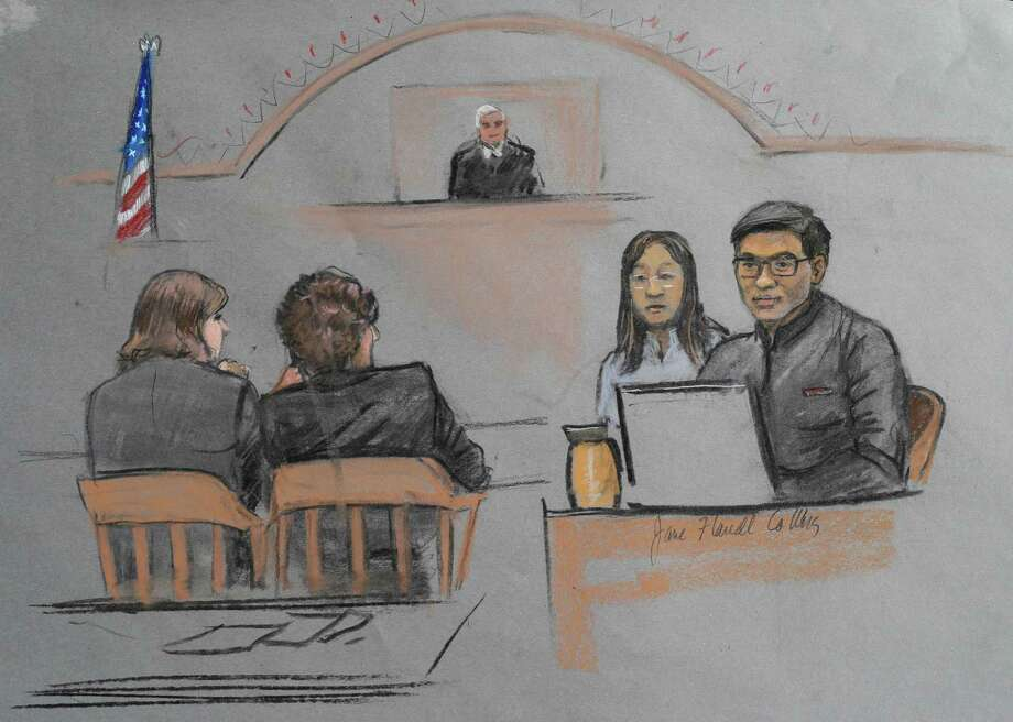 Carjacking victim Dun Meng (right) testifies with a translator at his side Thursday during Dzhokhar Tsarnaev's trial in Boston. Photo: Jane Flavell Collins / Associated Press / Jane Flavell Collins
