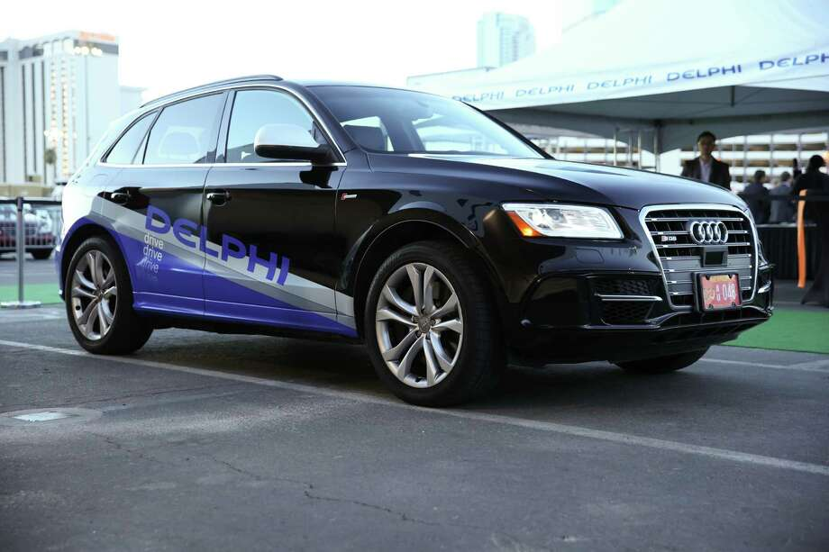 Delphi Automotive outfitted this Audi Q5 with laser sensors, radar and multiple cameras. It will soon be making a journey across the U.S. A person will sit behind the wheel at all times but won't touch it unless there's a situation the car can't handle.  Photo: HONS / Delphi