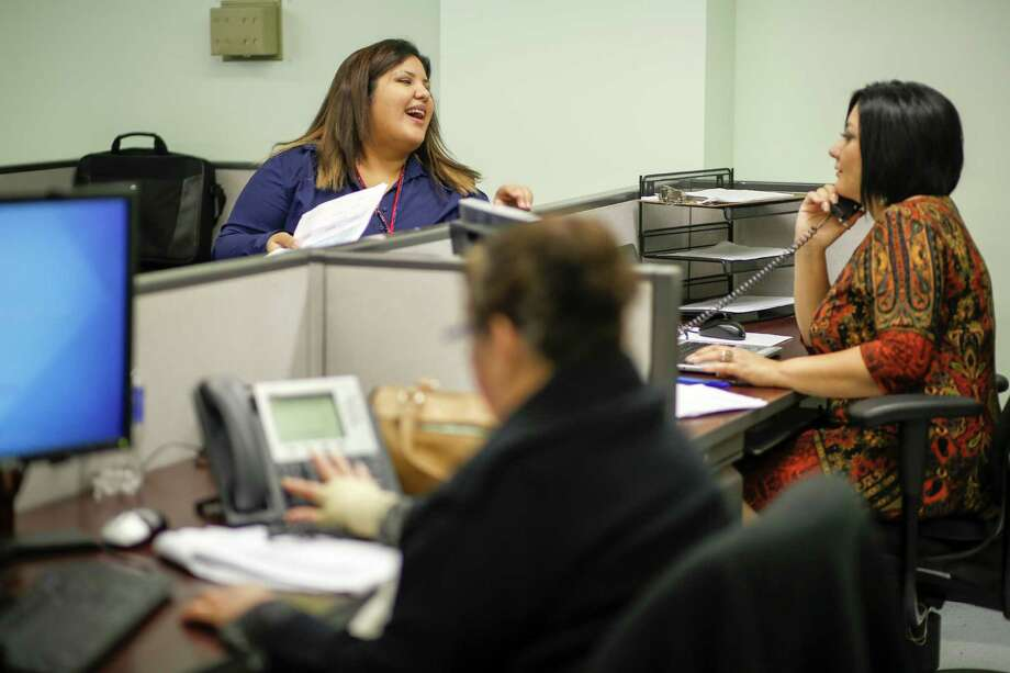 Raquel Rodriguez, left, and Leticia Chaw confer in November as the Houston Department of Health opens its call center to help people apply for insurance. Photo: Eric Kayne / Eric Kayne