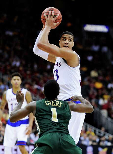 KANSAS CITY, MO - MARCH 13:  Landen Lucas #33 of the Kansas Jayhawks looks to pass over Kenny Chery #1 of the Baylor Bears in the second half during a semifinal game of the 2015 Big 12 Basketball Tournament at Sprint Center on March 13, 2015 in Kansas City, Missouri.  (Photo by Ed Zurga/Getty Images) Photo: Ed Zurga, Stringer / 2015 Getty Images