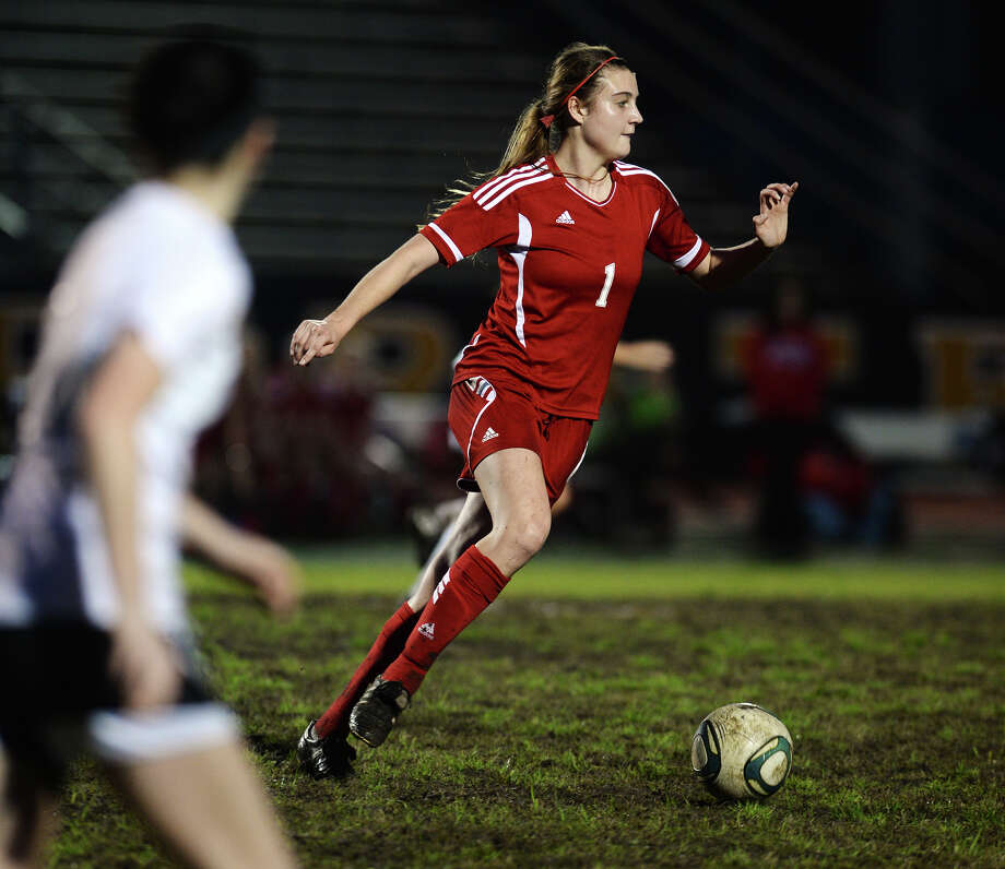 Lumberton's Kennedy Hardy, No. 1, controls the ball after receiving a pass during Friday's game against Vidor. The Vidor Lady Pirates soccer team hosted the  Lumberton Lady Raiders on Friday night.  Photo taken Friday 3/13/15  Jake Daniels/The Enterprise Photo: Jake Daniels / ©2015 The Beaumont Enterprise/Jake Daniels