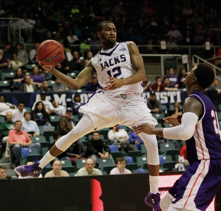 Stephen F. Austin Lumberjacks guard Dallas Cameron (12) looks for a teammate to pass to as Northwestern State Demons guard Sabri Thompson (21) looks on during the Southland Conference tournament at the Merrell Center on Friday, March 13, 2015 in Katy, Texas. (Bob Levey/For The Chronicle) Photo: Bob Levey, For The Chronicle / ©2015  Bob Levey