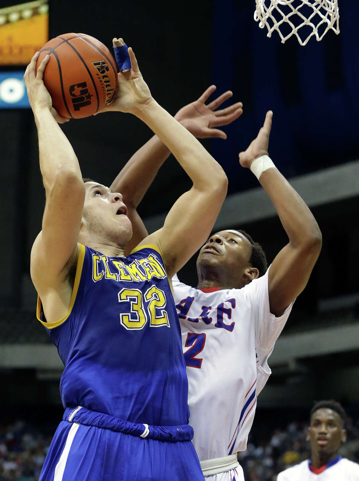 Buffalo forward Cayne Edwards takes the ball up against Bradley George as Clemens plays Houston Clear Lake in the 6A semifinals of the UIL state basketball tournament at the Alamodome in San Antonio on March 13, 2015.