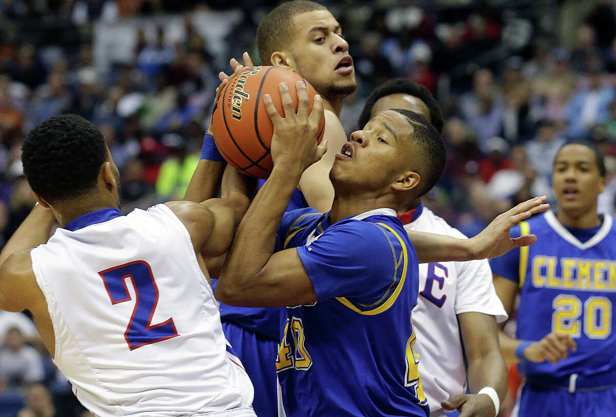 Clemens guard Frank Harris battles to get a tough offensive rebound as his plays Houston Clear Lake in the 6A semifinals of the UIL state basketball tournament at the Alamodome in San Antonio on March 13, 2015.
