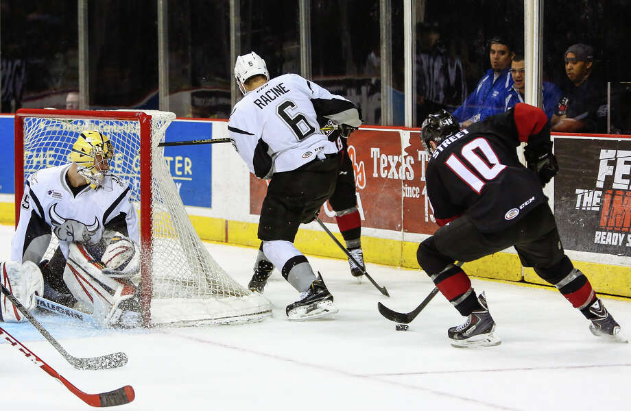 Lake Erie Monsters' Ben Street controls the puck right before scoring in the last seconds of  the 1st period of an AHL Hockey game at the AT&T Center in San Antonio, Texas on Friday March 13, 2015. (Josh Huskin/San Antonio Rampage) Photo: Josh Huskin / www.joshhuskin.com