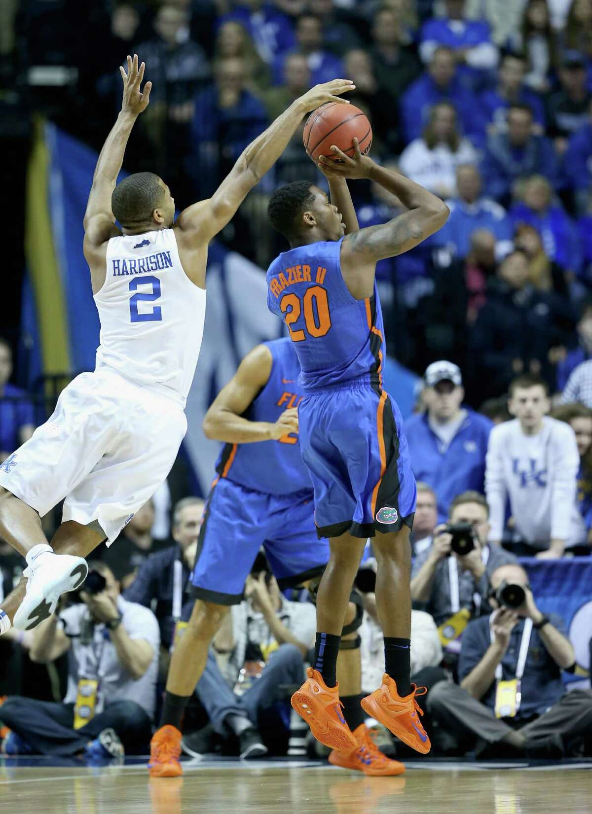 NASHVILLE, TN - MARCH 13: Aaron Harrison #2 of the Kentucky Wildcats blocks the shot of Michael Frazier #20 of the Florida Gators during the quaterfinals of the SEC Basketball Tournament at Bridgestone Arena on March 13, 2015 in Nashville, Tennessee. (Photo by Andy Lyons/Getty Images) ORG XMIT: 527094303