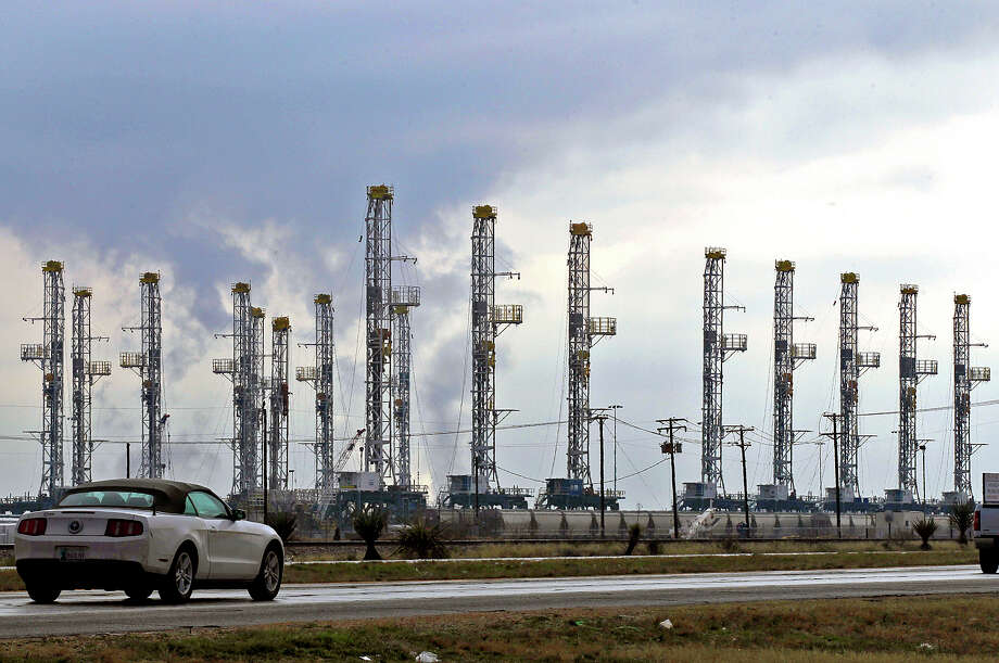 Rigs stacked in the Midland-Odessa area last month attest to the slower times in the oil patch. Many workers have been laid off. Photo: James Durbin, MBR / Midland Reporter-Telegram