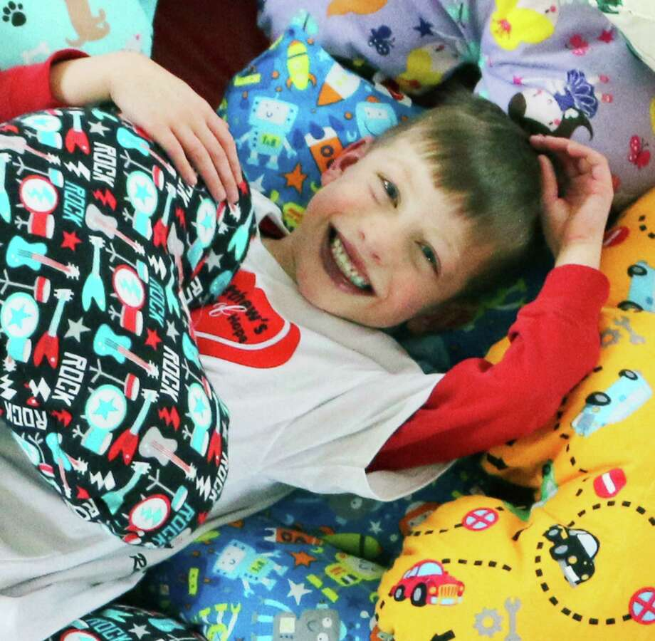 """The """"Hug A Heart Pillow Project"""" is an ongoing benefit for Matthew's Hearts of Hope, named for Matthew Hatcher of Sherman and created to help children born with congenital heart defects. March 2015   Courtesy of Matthew's Hearts of Hope Photo: Contributed Photo / The News-Times Contributed"""
