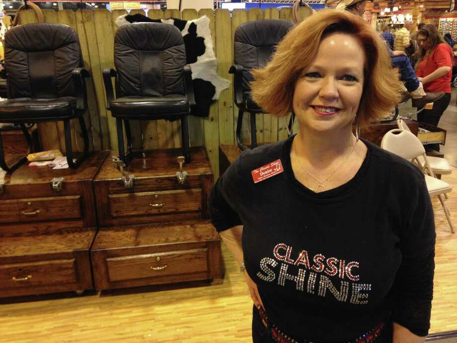 Denise Pullen, owner of The Classic Shine, poses Friday, March 13, 2015, at the NRG Center. The Classic Shine is one of two boot shining companies at the Houston Livestock Show and Rodeo. Photo: Andrea Rumbaugh