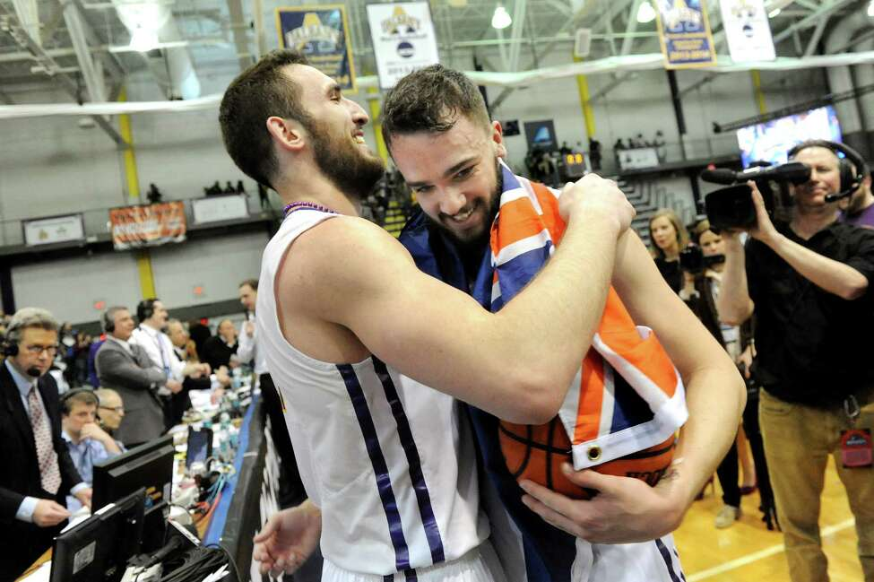UAlbany's Sam Rowley, left, and Peter Hooley embrace after a thrilling 51-50 win over Stony Brook during their America East Championship game on Saturday, March 13, 2015, at UAlbany. Hooley hit a 3-point buzzer-beater to win the game. (Cindy Schultz / Times Union)