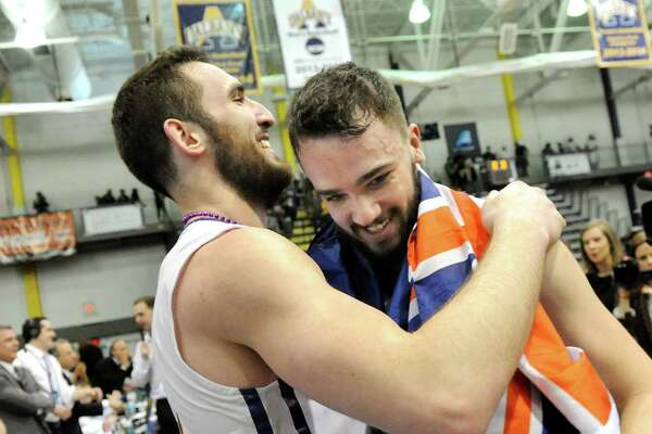 UAlbany's Sam Rowley, left, and Peter Hooley embrace when they win 51-50 over Stoney Brook during their America East Championship game on Saturday, March 13, 2015, at UAlbany in Albany, N.Y. Hooley hit a 3-point buzzer beater to win the game. (Cindy Schultz / Times Union)