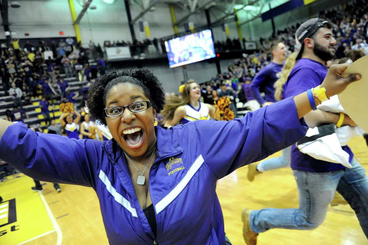 UAlbany's pep band member storms the floor when they win 51-50 over Stoney Brook during their America East Championship game on Saturday, March 13, 2015, at UAlbany in Albany, N.Y. (Cindy Schultz / Times Union)