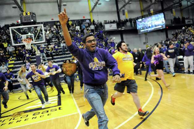 UAlbany students storm the floor when they win 51-50 over Stoney Brook during their America East Championship game on Saturday, March 13, 2015, at UAlbany in Albany, N.Y. (Cindy Schultz / Times Union) Photo: Cindy Schultz / 00030954A