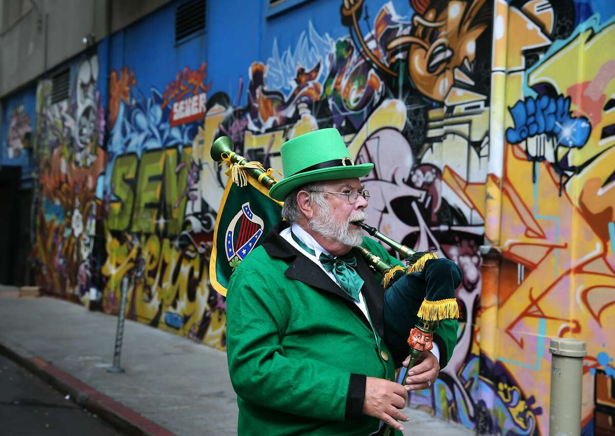 Dressed as a leprechuan, Alonso Chattan warms up with his bagpipes before marching with the sheet metal workers in the St. Patrick's Day Parade on Market Street in San Francisco, Calif. on Saturday, March 14, 2015.