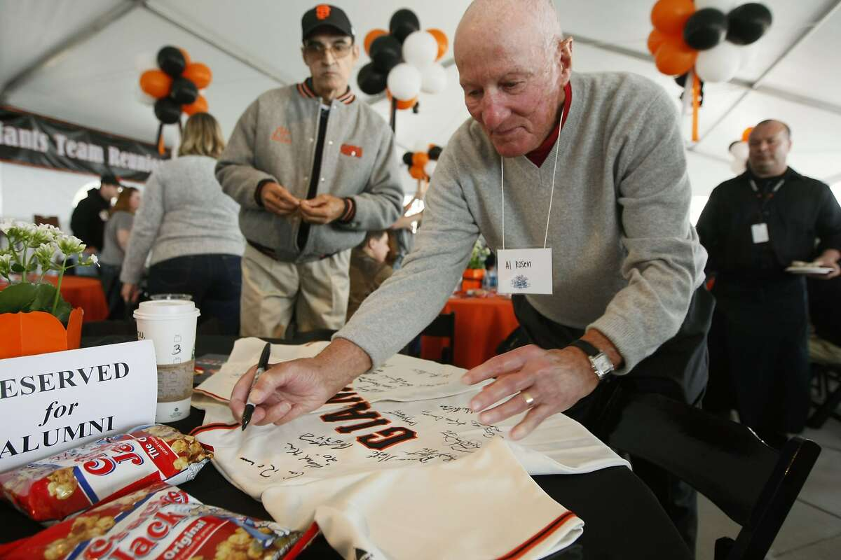 Al Rosen former General Manager of the San Francisco Giants signs a jersey owned by Jessica LaCoss from Visalia Ca. LaCross plans on donating it to her non-profit employer so it can be auctioned off at a fund raiser. Proteus Inc. is planning. The San Francisco Giants celebrated the twenty year reunion of the National League Championship team from 1989 AT&T Park Friday June 12. 2009