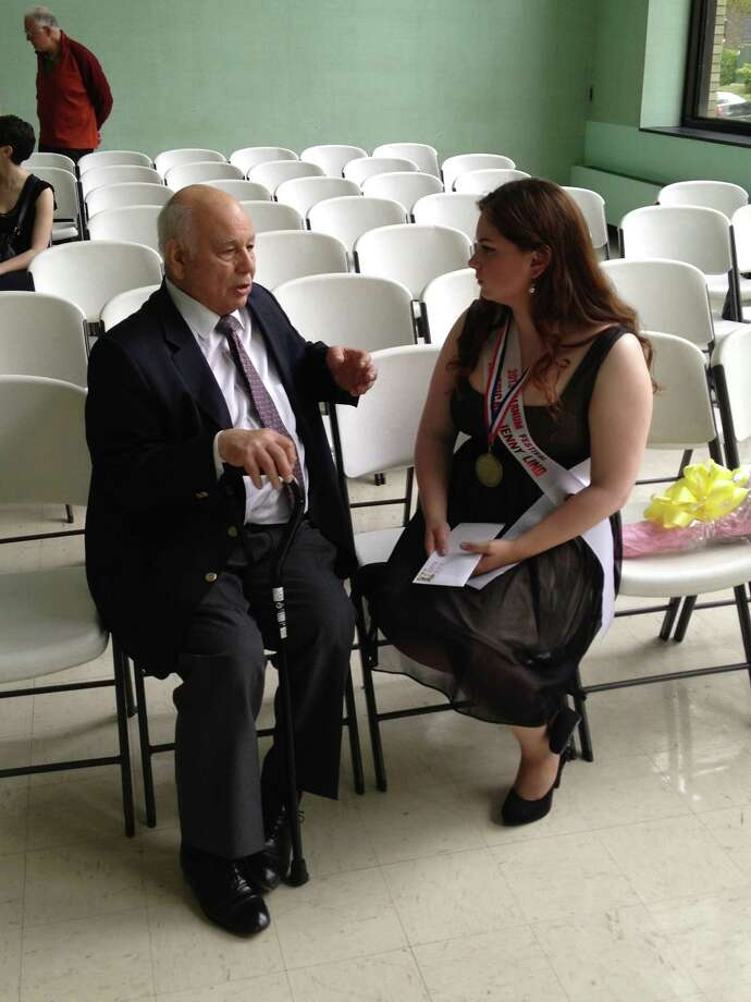 Robert S. Genualdi, who died Saturday, is shown in a Connecticut Post archived photo, chatting with former American Jenny Lind winner Kathryn Bowden. (An earlier version of this photo caption mentioned a Jenny Lind concert in Bridgeport in June. That concert was held in 2013. There is no such concert in June 2015.)  Photo: Contributed Photo / Connecticut Post Contributed