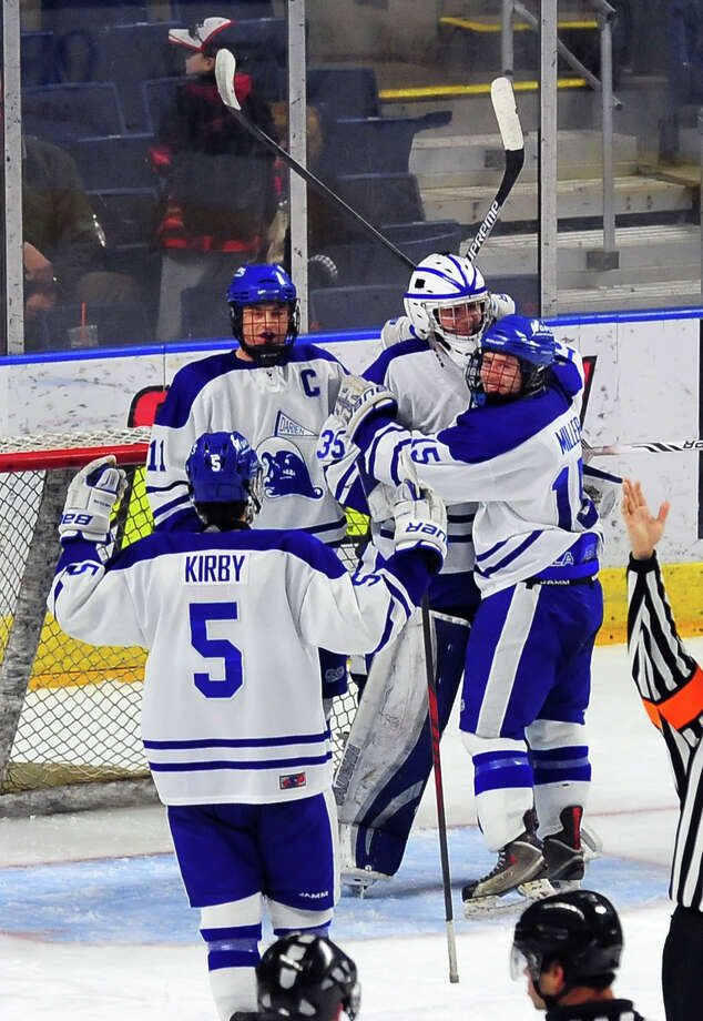 Darien celebrates its 3-1 win over Ridgefield, during CIAC boys hockey tournamnet action at the Webster Bank Arena in Bridgeport, Conn. on Saturday Mar. 14, 2015. Photo: Christian Abraham / Connecticut Post