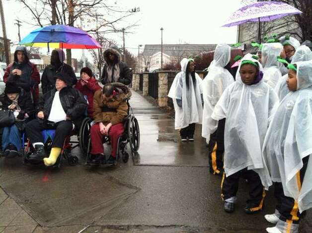 Kids in ponchos ready for rain and Albany's St. Patrick's Day parade. (Michael P. Farrell/Times Union)