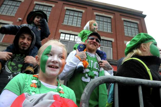Eight-year-old Jersey Lee Reynolds, left, of Ballston Spa watches the 65th Annual Albany St. Patrick's Day Parade on Saturday March 14, 2015 in Albany, N.Y.  (Michael P. Farrell/Times Union) Photo: Michael P. Farrell / 00030751A