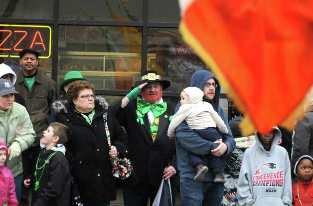 Bob O'Keefe, center, of East Greenbush salutes as the Irish flag passes by during the 65th Annual Albany St. Patrick's Day Parade on Saturday March 14, 2015 in Albany, N.Y.  (Michael P. Farrell/Times Union) Photo: Michael P. Farrell / 00030751A