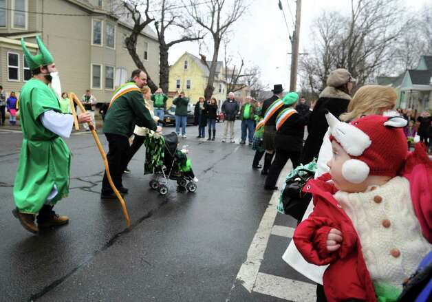 Nine-month-old Grace Collins, right, of Albany watches the North Albany Limerick St. Patrick's Day Parade on Saturday March 14, 2015 in Albany, N.Y.  (Michael P. Farrell/Times Union) Photo: Michael P. Farrell / 00030751A