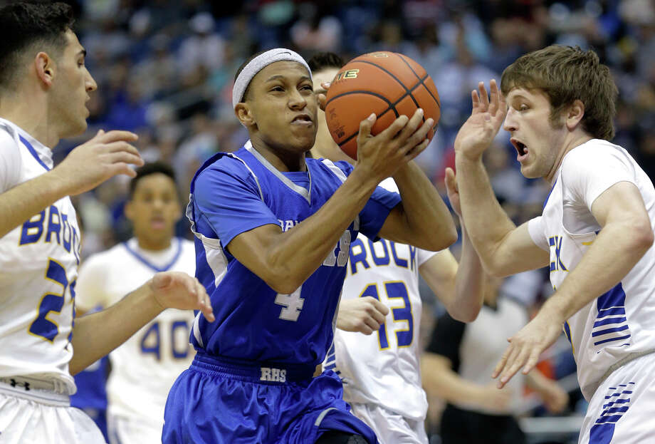 Ro-Hawk guard Shaun Jackson presses into the middle in the first half as Randolph plays Brock in the 3A finals of the UIL state basketball tournament at the Alamodome in San Antonio on March 14, 2015. Photo: Tom Reel / San Antonio Express-News