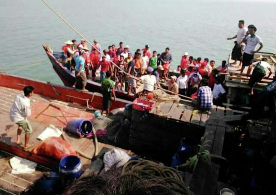 This image provided by DVB shows survivors who were saved after their ferry capsized near Kyauk Phyu port, Myanmar, on Saturday, March 14, 2015. A crowded double-decker ferry capsized in northwestern Myanmar after being slammed by huge waves, killing at least 21 people with nearly 50 others missing, officials said Saturday. (AP Photo/DVB) MANDATORY CREDIT Photo: TEL / DVB