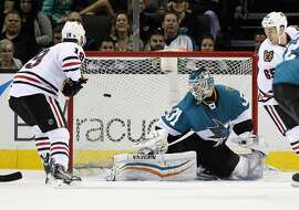 SAN JOSE, CA - MARCH 14:  A power-play goal by Duncan Keith #2 of the Chicago Blackhawks (not pictured) goes past Antti Niemi #31 of the San Jose Sharks at SAP Center on March 14, 2015 in San Jose, California.  (Photo by Ezra Shaw/Getty Images)