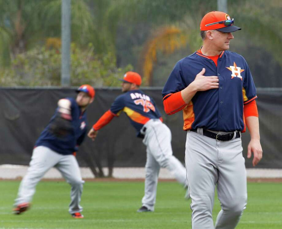 "Manager A.J. Hinch, above, is using a ""getting to know you"" approach this spring. In addition to impromptu Q&A sessions, he had pitcher Mark Appel, left, and shortstop Carlos Correa, right, interview all the players and make a presentation to the team. Photo: Karen Warren, Staff / © 2015 Houston Chronicle"