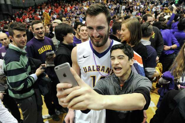 UAlbany's Sam Rowley, center, allows a selfie with a fan when they win 51-50 over Stoney Brook during their America East Championship game on Saturday, March 13, 2015, at UAlbany in Albany, N.Y. (Cindy Schultz / Times Union) Photo: Cindy Schultz / 00030954A