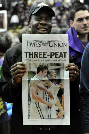 UAlbany fan Abner Jeanpierre holds the Times Union special edition when they win 51-50 over Stoney Brook during their America East Championship game on Saturday, March 13, 2015, at UAlbany in Albany, N.Y. (Cindy Schultz / Times Union) Photo: Cindy Schultz / 00030954A