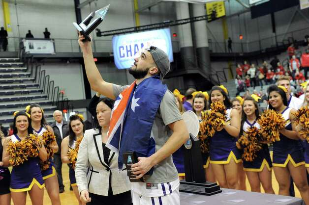 UAlbany's Peter Hooley holds up the trophy for Most Outstanding Player after they win 51-50 over Stoney Brook during their America East Championship game on Saturday, March 13, 2015, at UAlbany in Albany, N.Y. (Cindy Schultz / Times Union) Photo: Cindy Schultz / 00030954A