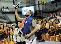 UAlbany's Peter Hooley holds up the trophy for Most Outstanding Player after they win 51-50 over Stoney Brook during their America East Championship game on Saturday, March 13, 2015, at UAlbany in Albany, N.Y. (Cindy Schultz / Times Union)