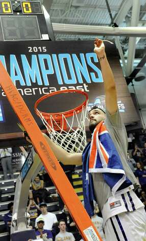 UAlbany's Peter Hooley holds up a piece of the net as they celebrate their America East Championship win over Stony Brook on Saturday, March 13, 2015, at UAlbany in Albany, N.Y. (Cindy Schultz / Times Union) Photo: Cindy Schultz / 00030954A