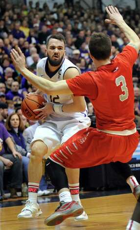 UAlbany'S Peter Hooley, left, controls the ball as Stony Brook's Kameron Mitchell defends during the America East Championship game  on Saturday, March 13, 2015, at UAlbany in Albany, N.Y. (Cindy Schultz / Times Union) Photo: Cindy Schultz / 00030954A