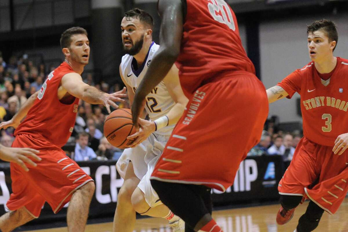 UAlbany's Peter Hooley, center, finds himself in heavy traffic during the America East Championship game against Stony Brook on Saturday, March 13, 2015, at UAlbany in Albany, N.Y. (Cindy Schultz / Times Union)
