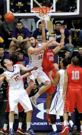 UAlbany's Sam Rowley, center, knocks away a shot from Stony Brook's Scott King during their America East Championship game on Saturday, March 13, 2015, at UAlbany in Albany, N.Y. (Cindy Schultz / Times Union) Photo: Cindy Schultz / 00030954A