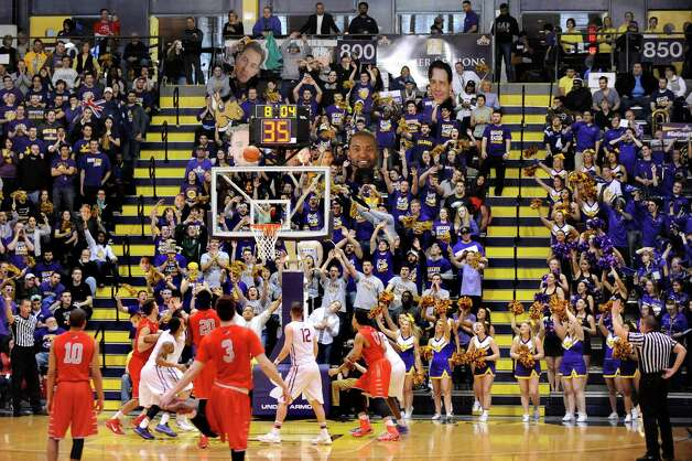 UAlbany's student section tries to distract a Stony Brook player on the free throw line during their America East Championship game on Saturday, March 13, 2015, at UAlbany in Albany, N.Y. (Cindy Schultz / Times Union) Photo: Cindy Schultz / 00030954A