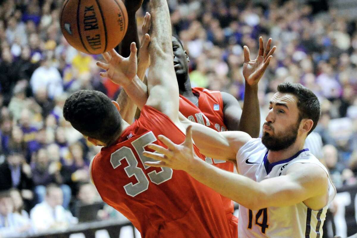 UAlbany's Sam Rowley, right, battles for a rebound with Stoney Brook's Scott King during their America East Championship game on Saturday, March 13, 2015, at UAlbany in Albany, N.Y. (Cindy Schultz / Times Union)