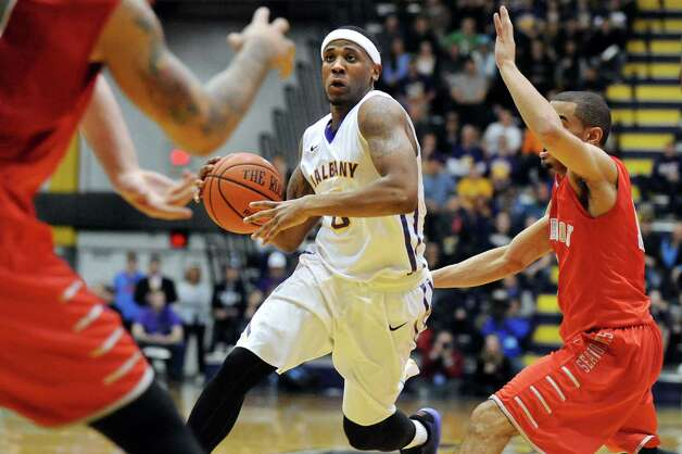 UAlbany's Evan Singletary, center, controls the ball as Stony Brook's Carson Puriefoy, right, defends during their America East Championship game on Saturday, March 13, 2015, at UAlbany in Albany, N.Y. (Cindy Schultz / Times Union) Photo: Cindy Schultz / 00030954A