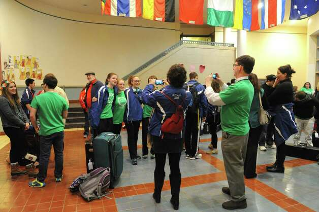 The Albany Marching Falcons, the marching band and color guard for the City School District of Albany, leave for a long-awaited whirlwind tour of Ireland that includes a gig performing in the Dublin St. Patrick's Day parade on Saturday March 14, 2015 in Albany, N.Y.  (Michael P. Farrell/Times Union) Photo: Michael P. Farrell / 00031020A