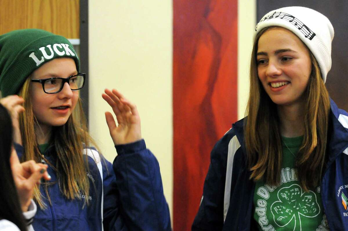 Saxophonist Julia Azarian-Kozer, left, and flautist Aine Haugh of the Albany Marching Falcons, the marching band and color guard for the City School District of Albany, leave for a long-awaited whirlwind tour of Ireland that includes a gig performing in the Dublin St. Patrick?'s Day parade on Saturday March 14, 2015 in Albany, N.Y. (Michael P. Farrell/Times Union)