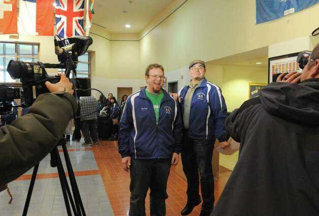 Band director Bryan Cady, left, and associate director John Halvorsen are interviewd prior to the Albany Marching Falcons, the marching band and color guard for the City School District of Albany, leave for a long-awaited whirlwind tour of Ireland that includes a gig performing in the Dublin St. Patrick's Day parade on Saturday March 14, 2015 in Albany, N.Y.  (Michael P. Farrell/Times Union) Photo: Michael P. Farrell / 00031020A