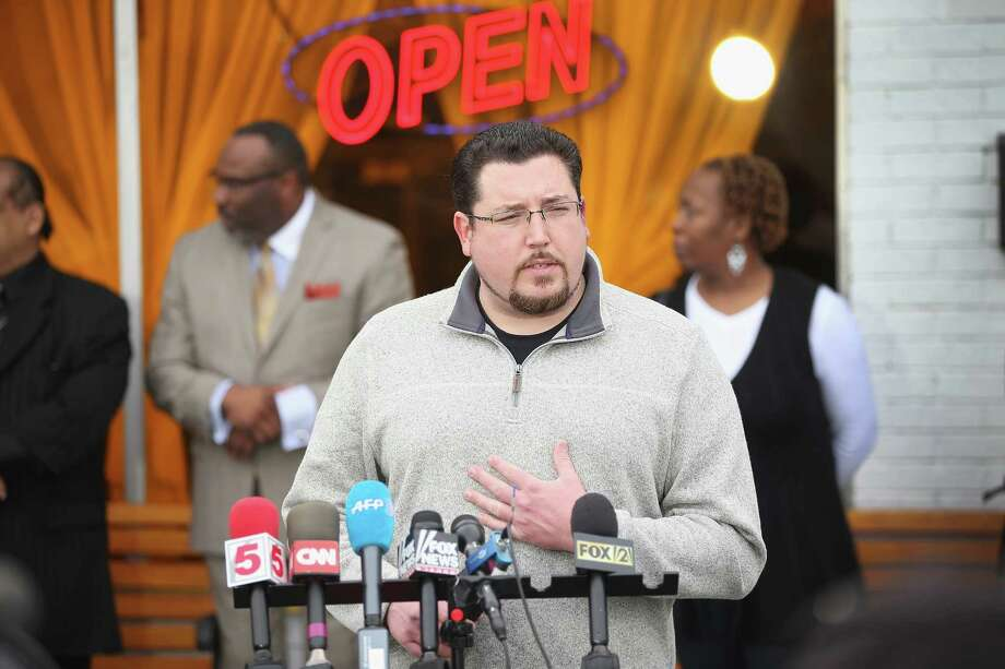 Mayor James Knowles joins with business owners to speak to the press outside a restaurant in Ferguson, Mo. The town's voters go to the polls on April 7. Photo: Scott Olson / Getty Images / 2015 Getty Images