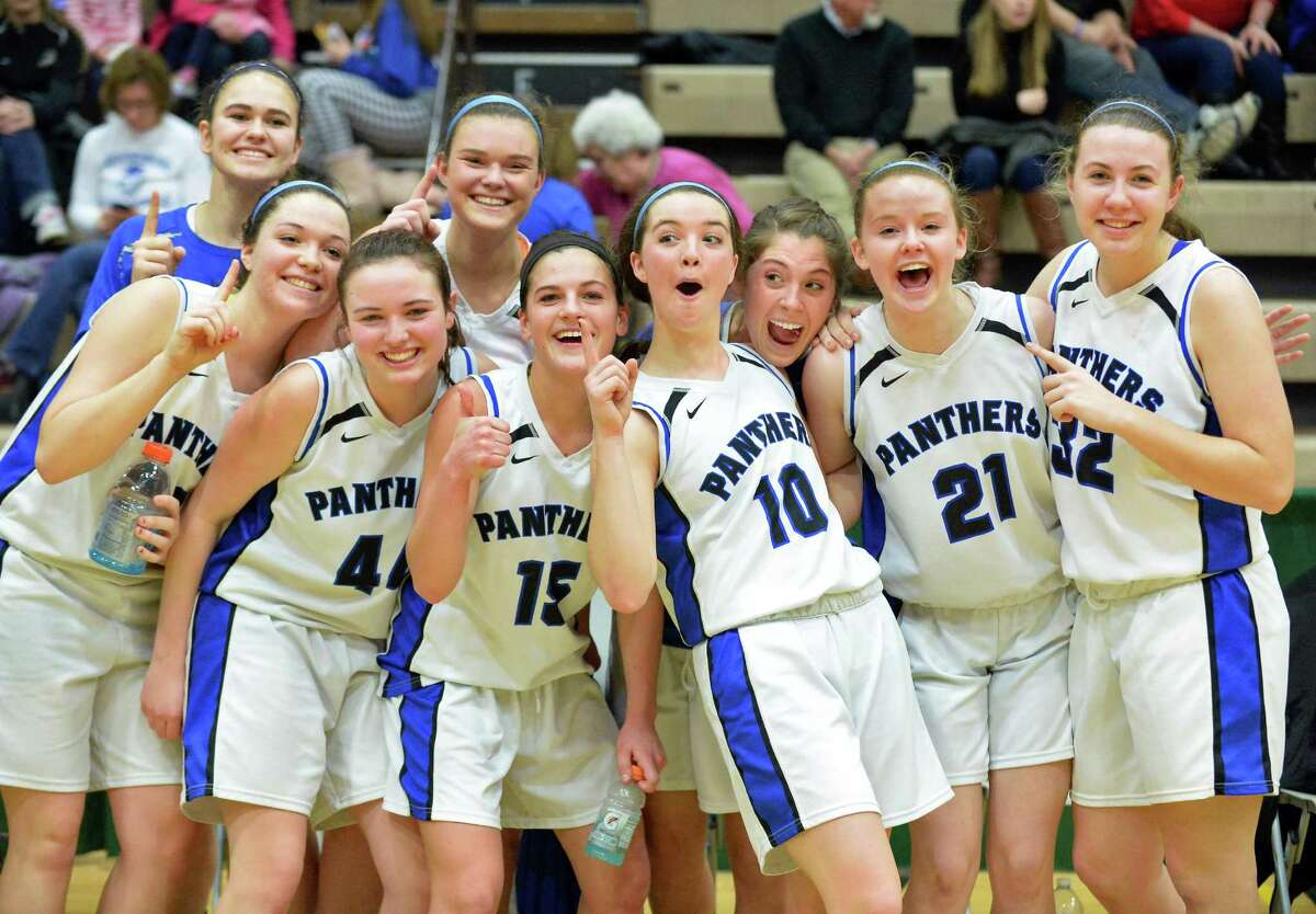 Hoosick Falls players celebrate their Class B regional final win over Canton at HVCC Saturday March 14, 2015 in Troy, NY. (John Carl D'Annibale / Times Union)