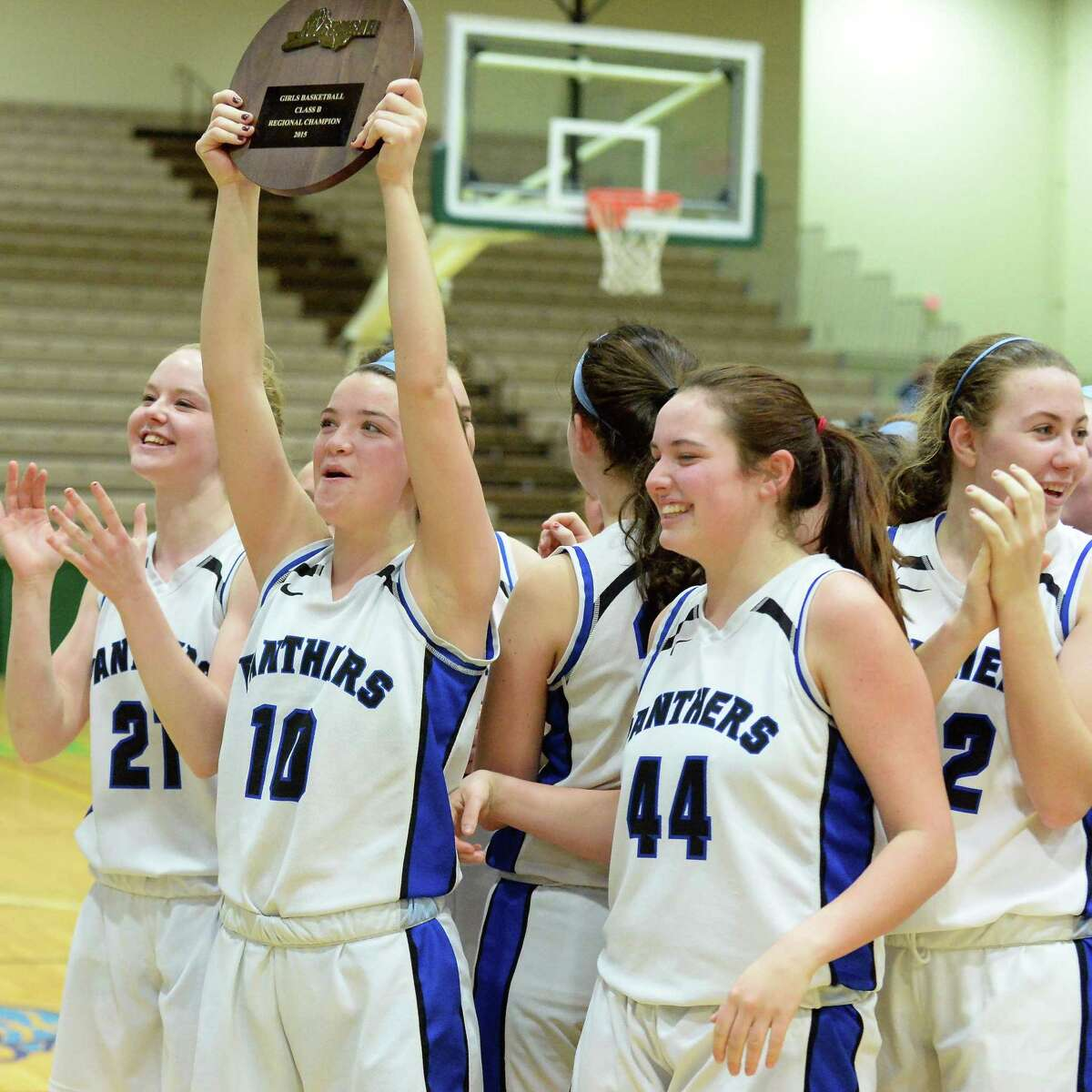 Hoosick Falls' #10 Rachel Pine holds aloft their Class B regional final plaque after defeating Canton at HVCC Saturday March 14, 2015 in Troy, NY. (John Carl D'Annibale / Times Union)