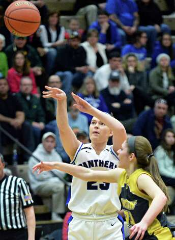 Hoosick Falls' #23, left, takes a shot during the Class B girls' basketball regional final against Canton at HVCC Saturday March 14, 2015 in Troy, NY.  (John Carl D'Annibale / Times Union) Photo: John Carl D'Annibale / 00031026A