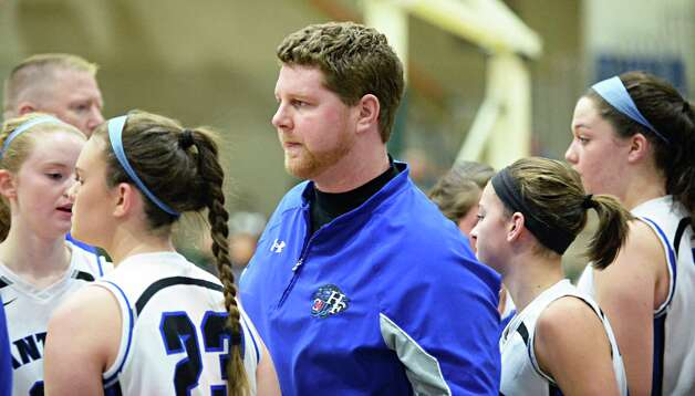 Hoosick Falls head coach Eamonn DeGraat, center, with players during the Class B girls' basketball regional final against Canton at HVCC Saturday March 14, 2015 in Troy, NY.  (John Carl D'Annibale / Times Union) Photo: John Carl D'Annibale / 00031026A