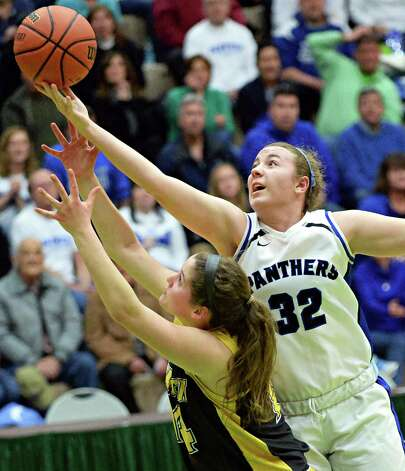 Hoosick Falls' #32 Megan Flynn, right, outreaches Canton's #14 Natalie DiSalvo for a rebound during the Class B girls' basketball regional final at HVCC Saturday March 14, 2015 in Troy, NY.  (John Carl D'Annibale / Times Union) Photo: John Carl D'Annibale / 00031026A